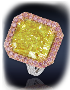 12.20 Ct. Natural Fancy Yellow Green VS2 Rectangular Modified Brilliant Cut Diamond Surrounded By 1.18 Ct. Fancy Pink Diamonds & 1.07 Ct. White Diamonds In A Pave' Set In 18K White Gold.